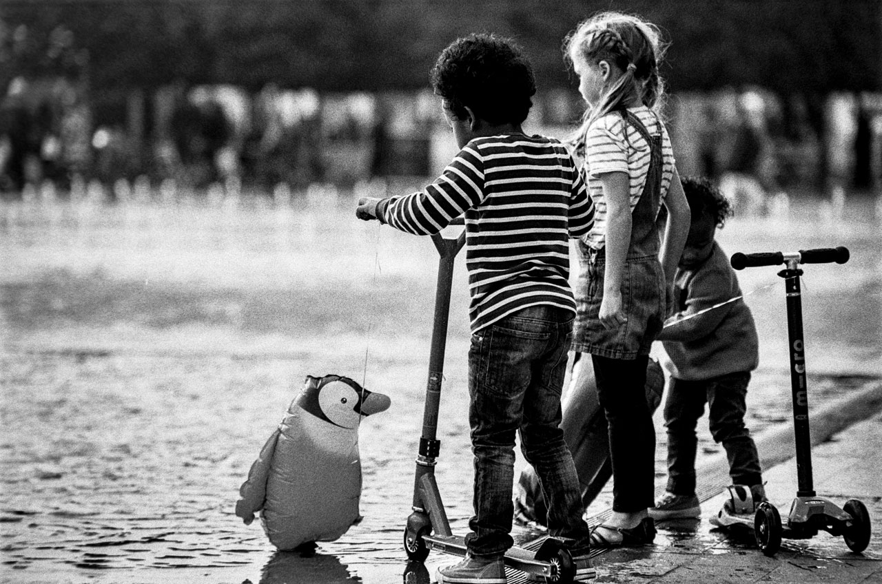 A penguin and kids